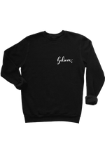 "A black sweatshirt with the word ""believe"" written on the left chest."
