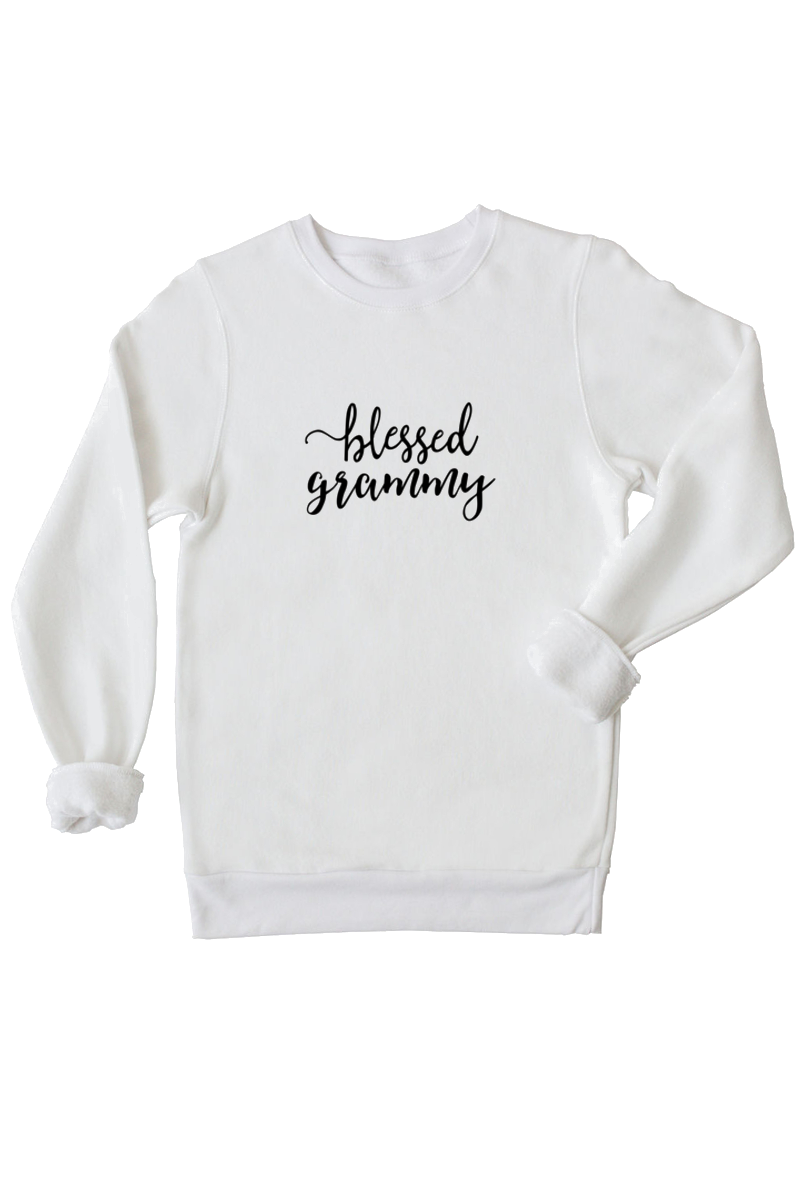 "A white sweatshirt with ""blessed grammy"" written on it."