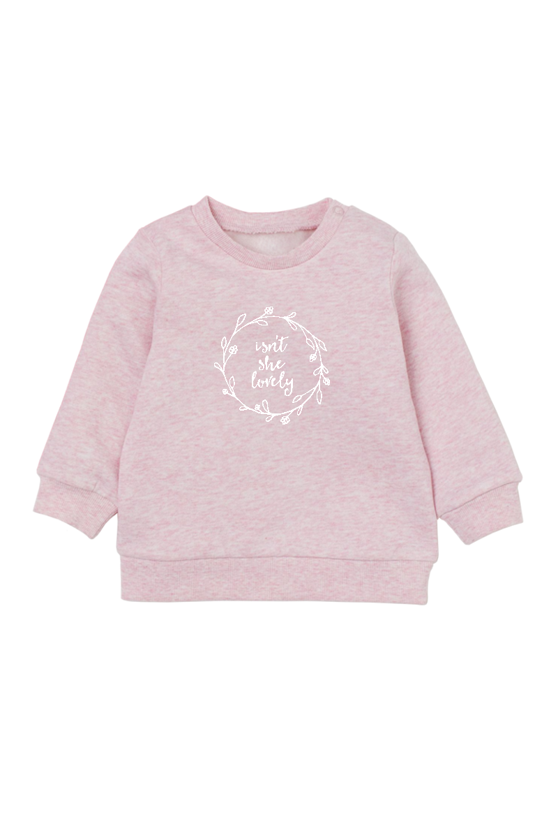 "Blush sweatshirt with the words ""isn't she lovely"" written inside a floral wreath."