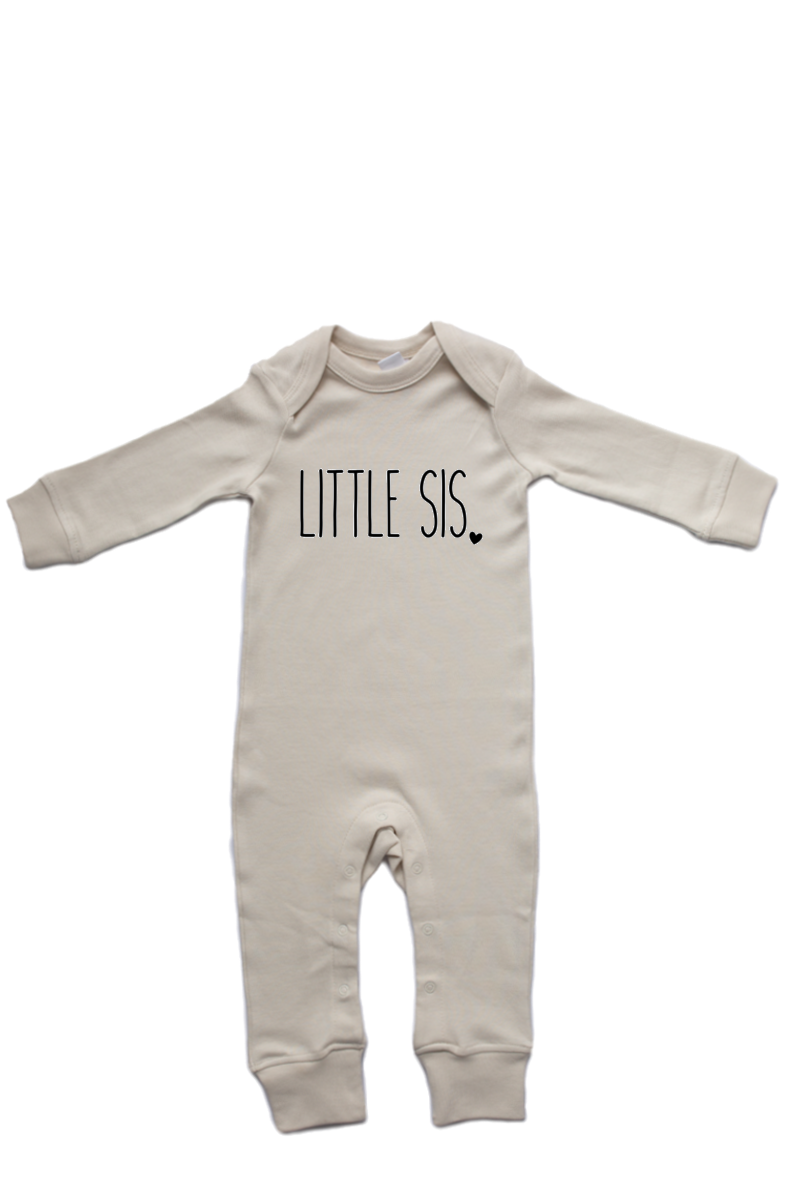 "A natural white baby romper with ""little sis"" written on it."
