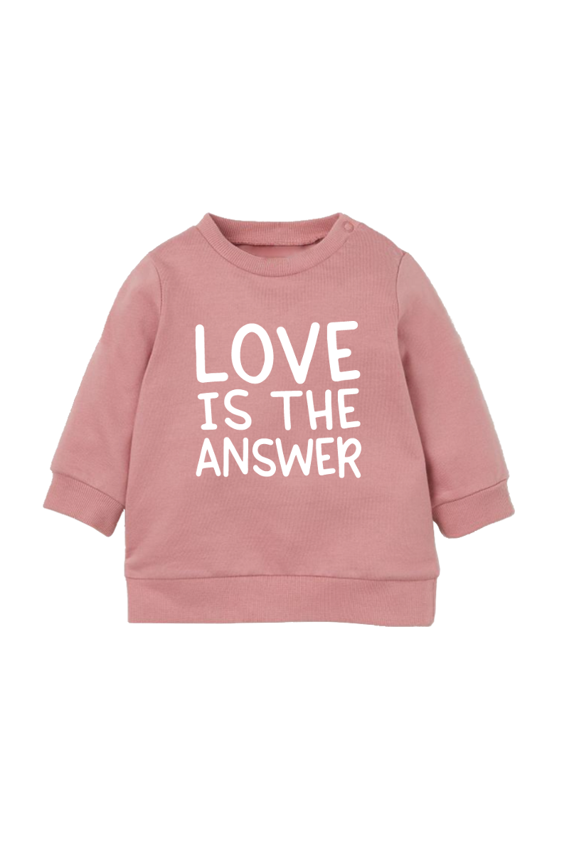 "A rose sweatshirt that says ""love is the answer""."