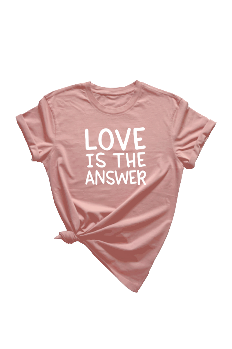 "A rose t-shirt that says ""LOVE IS THE ANSWER"" on it."