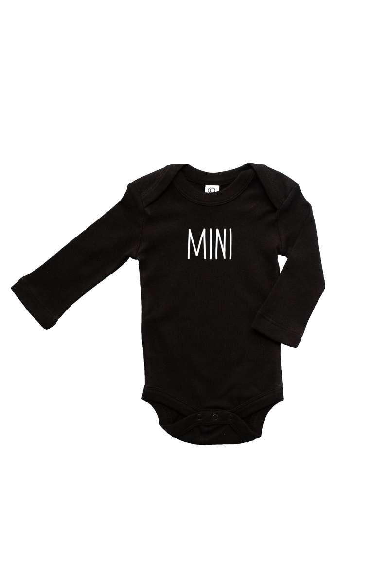 "A black long-sleeve bodysuit with ""mini"" written on it in a printed font."