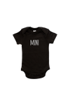 "A black short-sleeve bodysuit with ""mini"" written on it in a printed font."