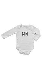 "A white long-sleeve bodysuit with ""mini"" written on it in a printed font."