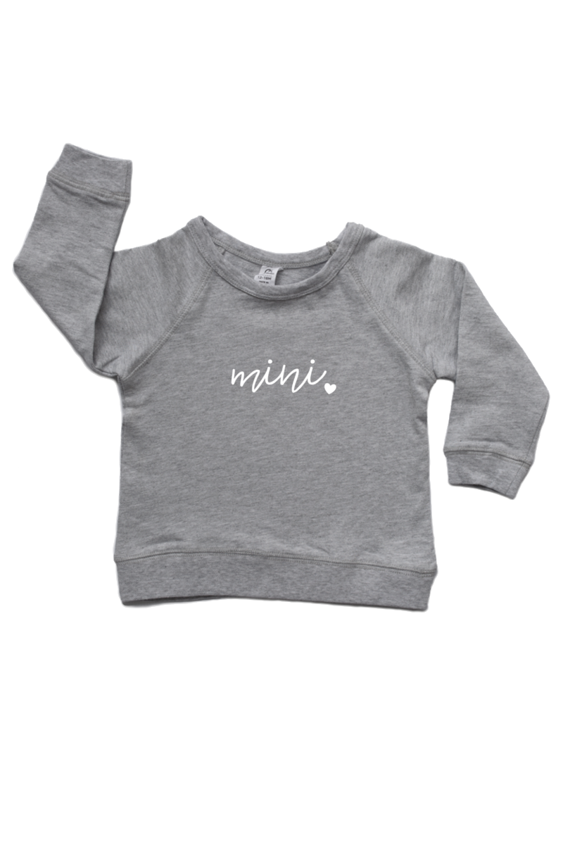 "A grey sweatshirt with ""mini"" written on it."