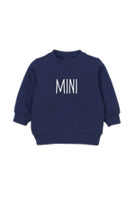 "A navy kids sweatshirt that says ""mini."""