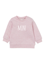 "A blush pink sweatshirt with ""mini"" written on it."