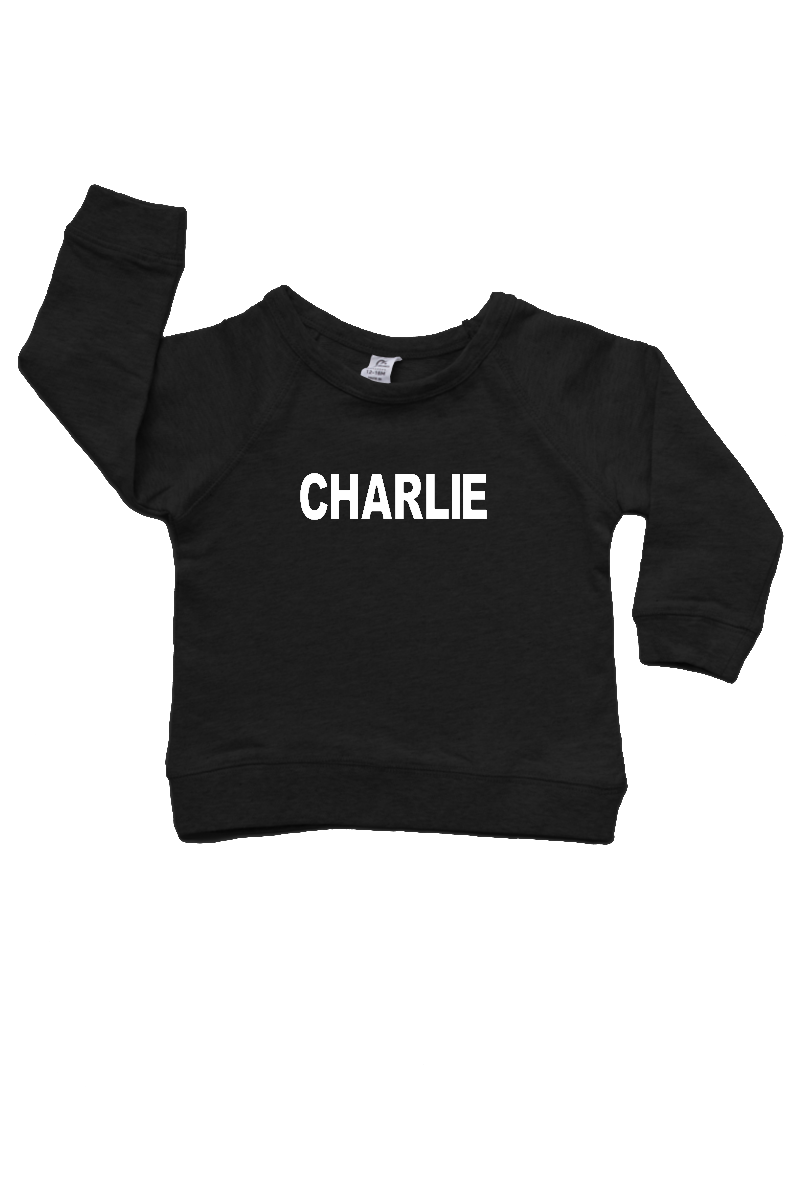 "Black sweatshirt with the name ""Charlie"" written on it."