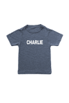 "Navy kids tee with ""Charlie"" written on it."