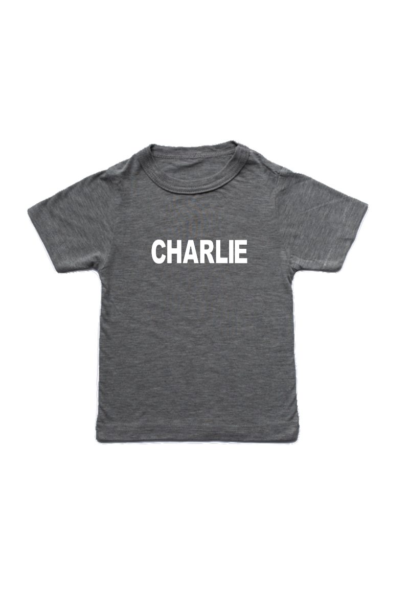 "Grey kids tee with ""Charlie"" written on it."