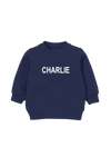 "A navy kids sweatshirt that says ""Charlie."""
