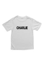 "White kids tee with ""Charlie"" written on it."