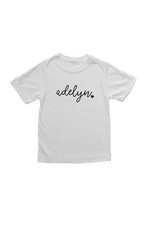 "A white kids t-shirt that says ""adelyn""."