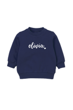 "A navy kids sweatshirt that says ""Olivia."""