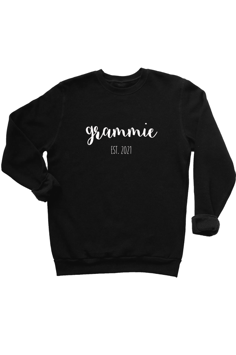 "A black sweatshirt that says ""grammie est. 2021""."
