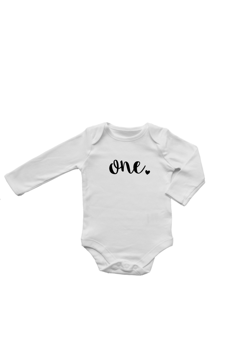 "A long-sleeve white bodysuit with ""one"" written on it in black."