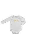"A long-sleeve white bodysuit with ""one"" written on it in gold."