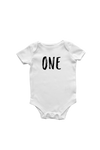 "A white bodysuit with ""one"" written on it in a marker font."