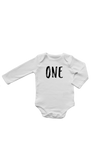 "A long-sleeve white bodysuit with ""one"" written on it in a marker font."