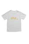 "White kids tee with ""one"" written on it in gold glitter."