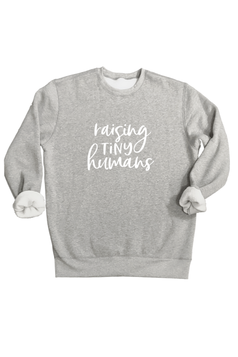 "A grey sweatshirt that says ""raising tiny humans""."