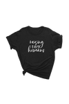"Black t-shirt with ""raising tiny humans"" written on it."