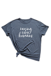 "Navy t-shirt with ""raising tiny humans"" written on it."