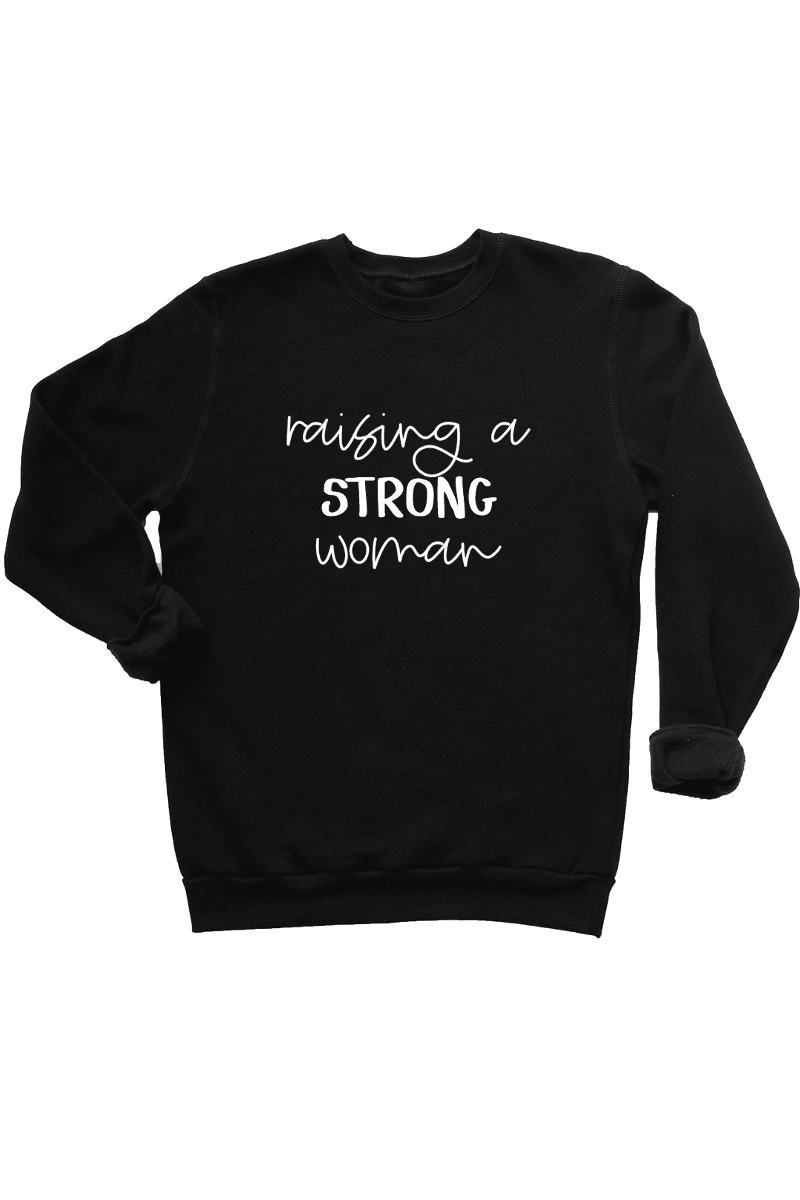 "Black sweatshirt with the words ""raising strong women"" written on it."