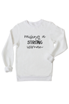 "White sweatshirt with the words ""raising a strong woman"" written on it."