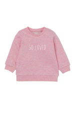 "A pink sweatshirt with ""so loved"" written on it."