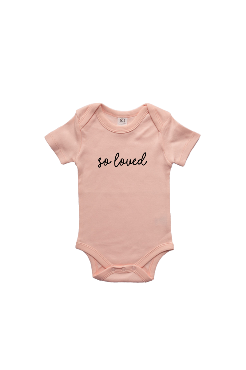 "A blush bodysuit with ""so loved"" written on it."