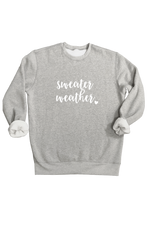 "A grey sweatshirt that says ""sweater weather""."