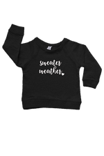 "A black sweatshirt with ""sweater weather"" written on it."