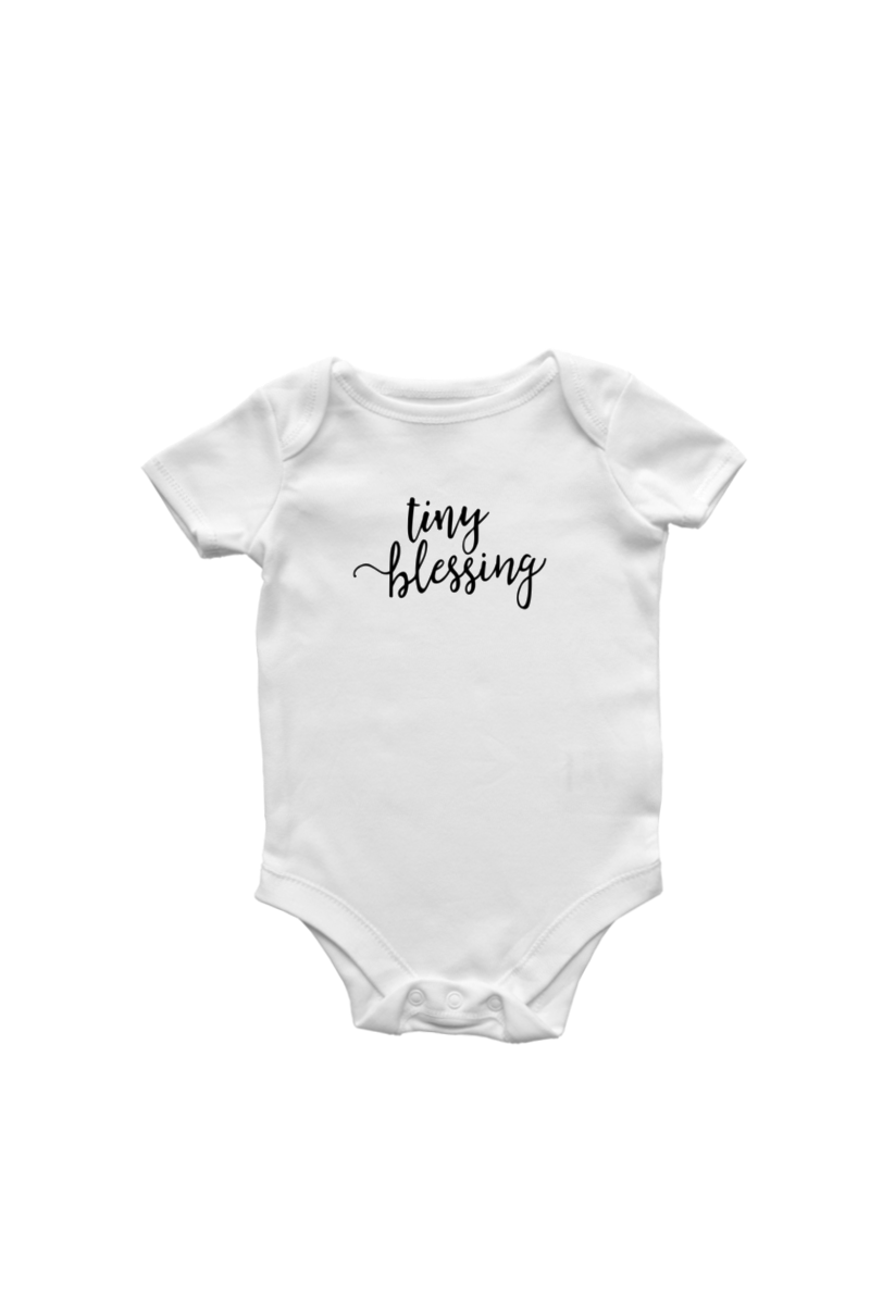 "A white short-sleeve bodysuit with the words ""tiny blessing"" written on it in a script font."