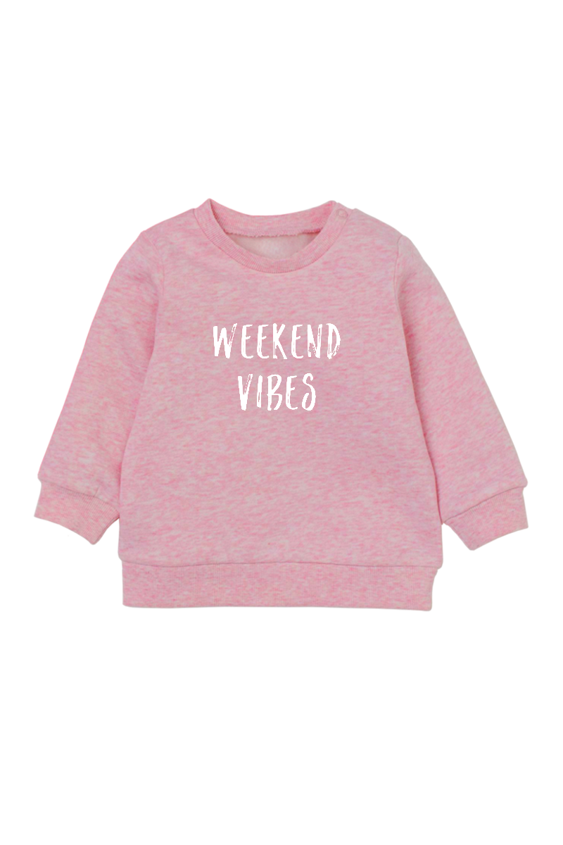 "A pink sweatshirt with ""weekend vibes"" written on it."