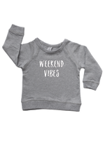 "A grey sweatshirt with ""weekend vibes"" written on it."