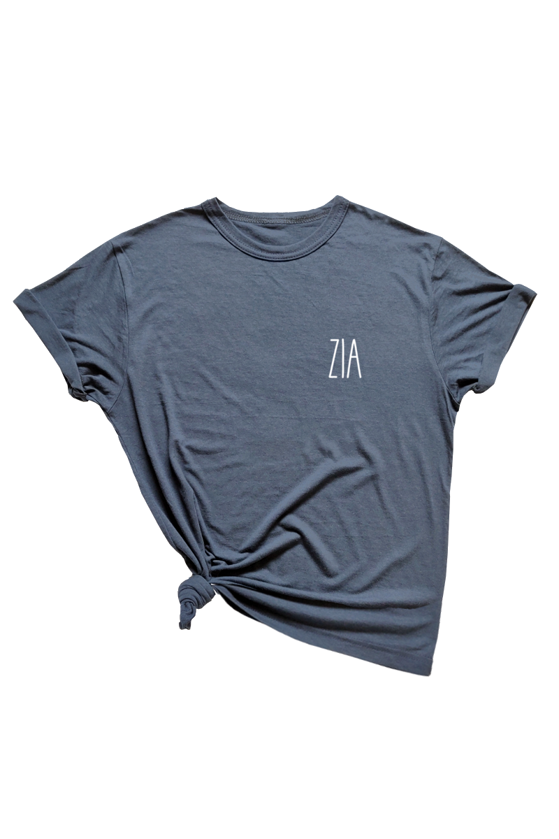 "A navy t-shirt that says ""zia."""