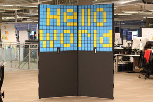 "Pair of SHAY boards covered in Post-It notes reading ""Hello World"""