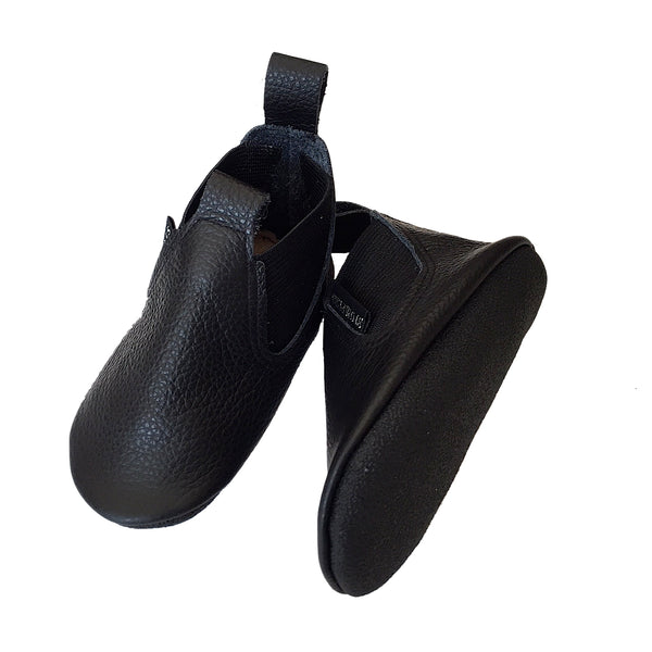 Black leather toddler boots sole