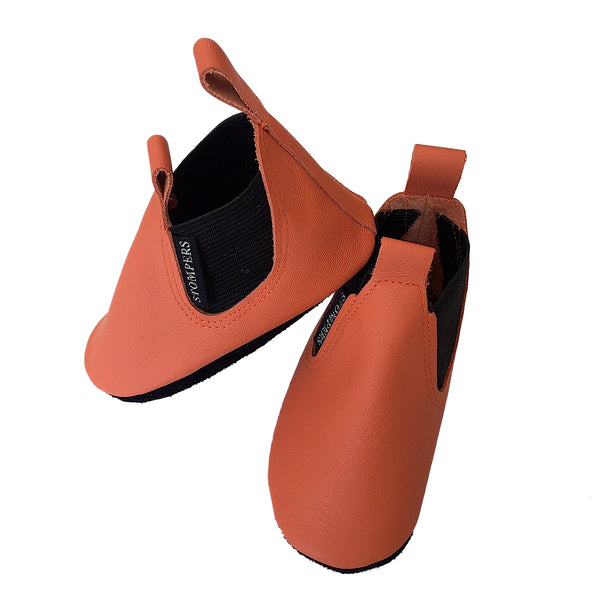 Orange leather baby boots side