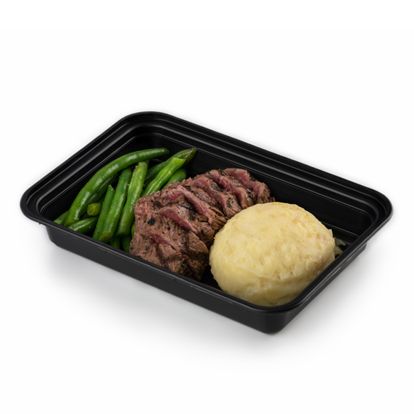 steak and potatoes in container