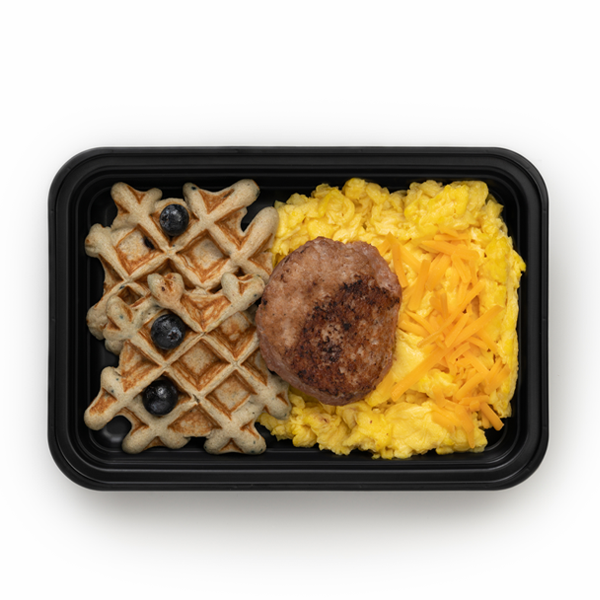 blueberry waffles and sausage in container overhead