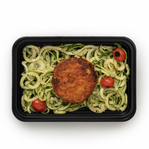 salmon cake and pesto zoodles in container overhead