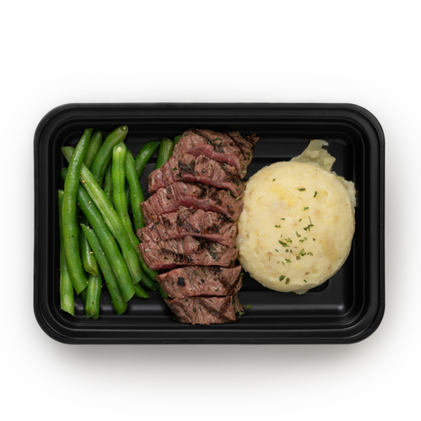 steak and potatoes in container overhead