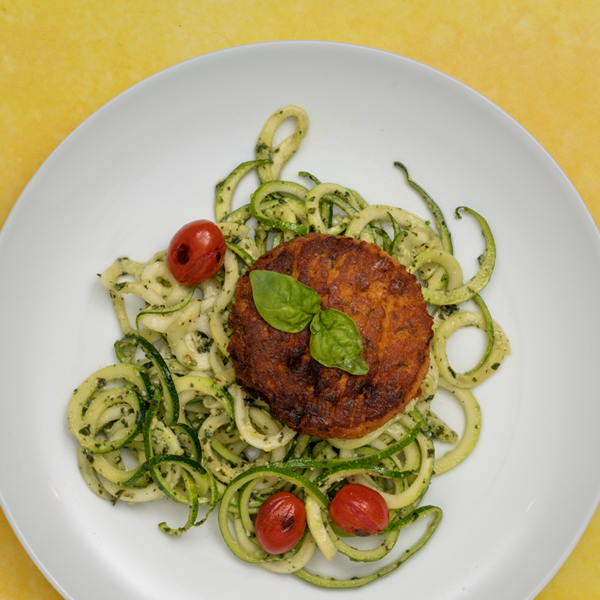 salmon cake and pesto zoodles overhead