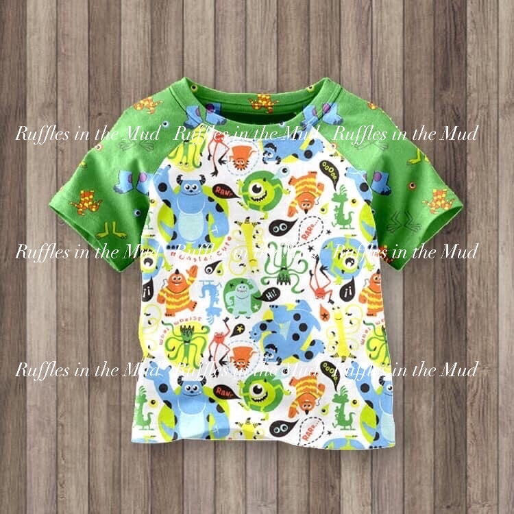 6/12m-7/8 • Monsters Inc Raglan