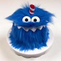 picture of a blue monster birthday cake with a red candle
