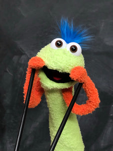 Green sock puppet with orange arms and blue hair