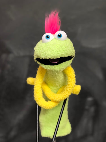 Green sock puppet with yellow arms and pink mowhawk